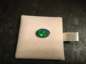 My Lightning Ridge black opal. It looks big but it's smaller than my pinkie fingernail. I love it!
