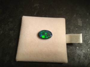 My Lightning Ridge black opal. It looks big but it's smaller than my pinkie fingernail. I love it!
